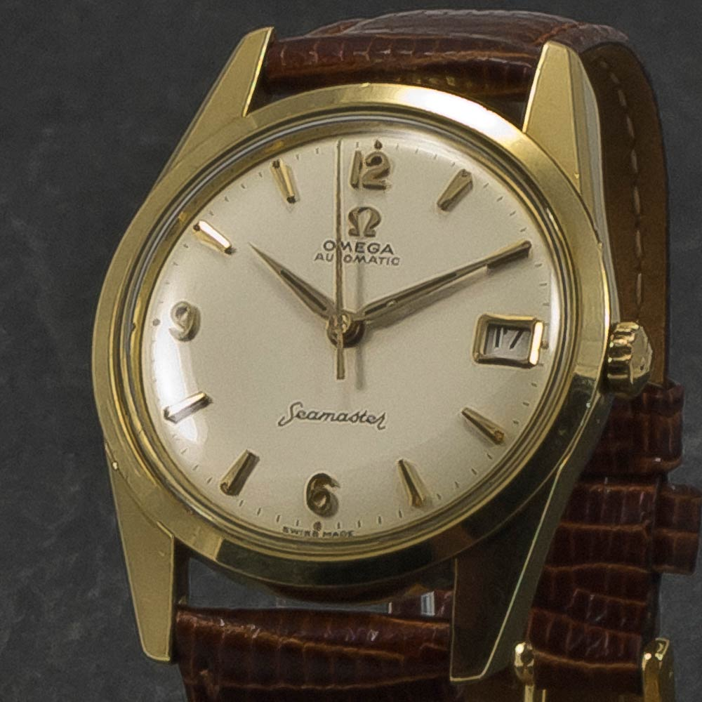 Omega-Seamaster-Date-Gold-caped-001-X-003